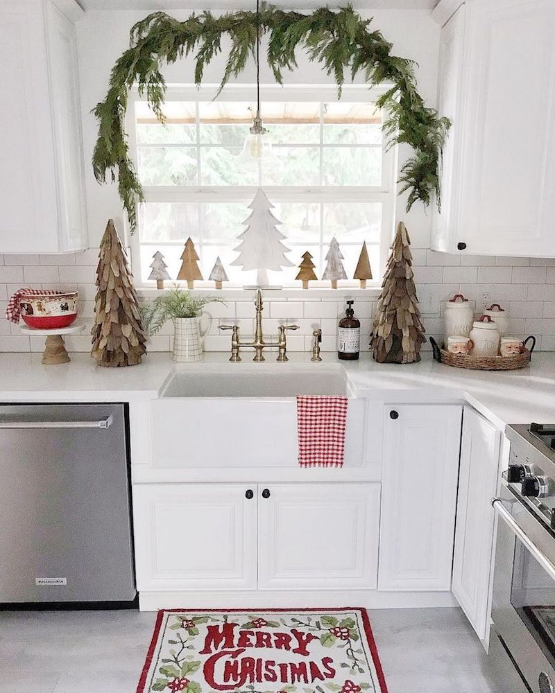 Wooden Christmas Trees around the Sink via @thethankfulfarmhouse