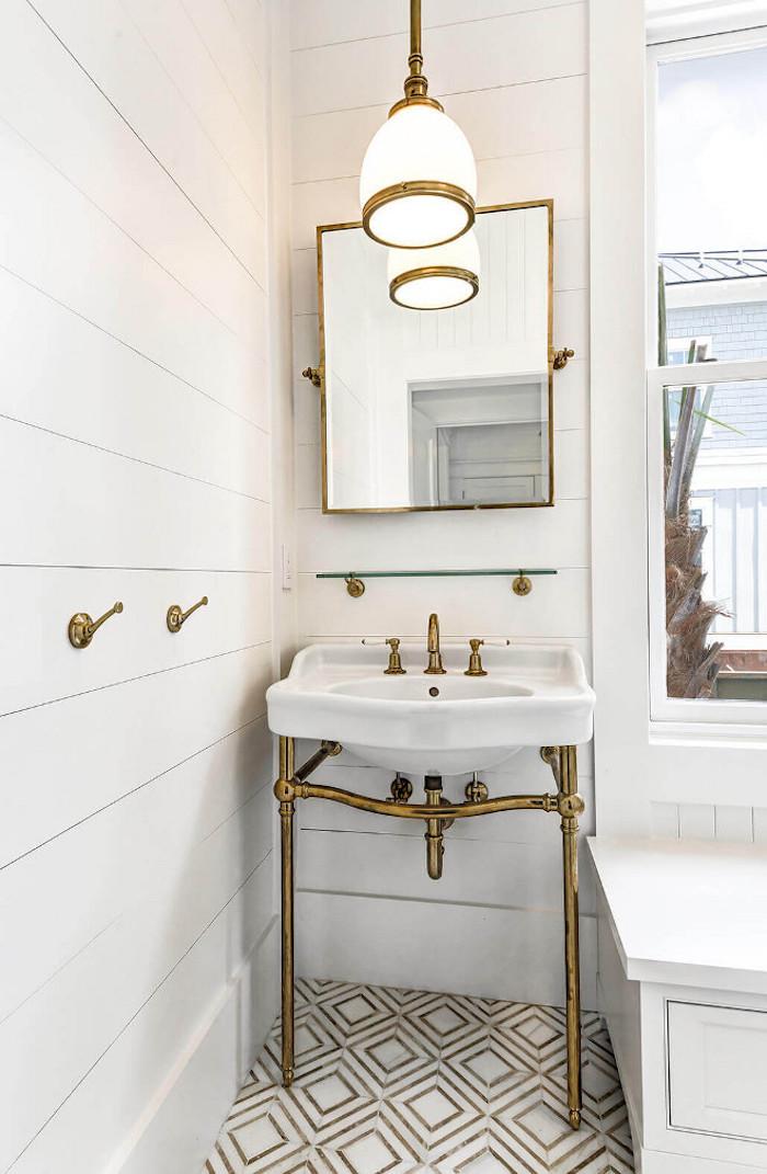 Bathroom with shiplap walls, Yildiz marble mosaic floor tile and brass bathroom vanity