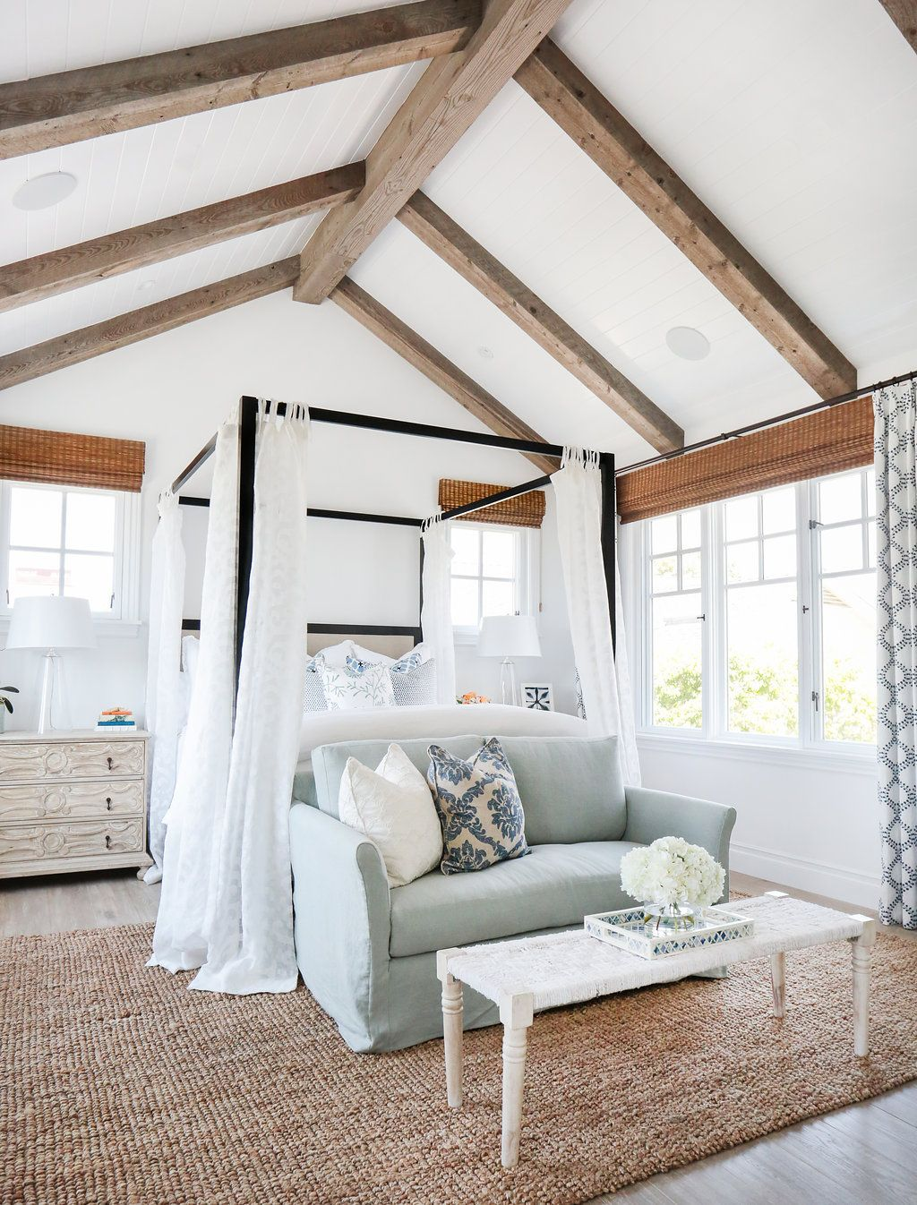 Bedroom with Vaulted Faux Wood Ceiling Beams via blackbanddesign