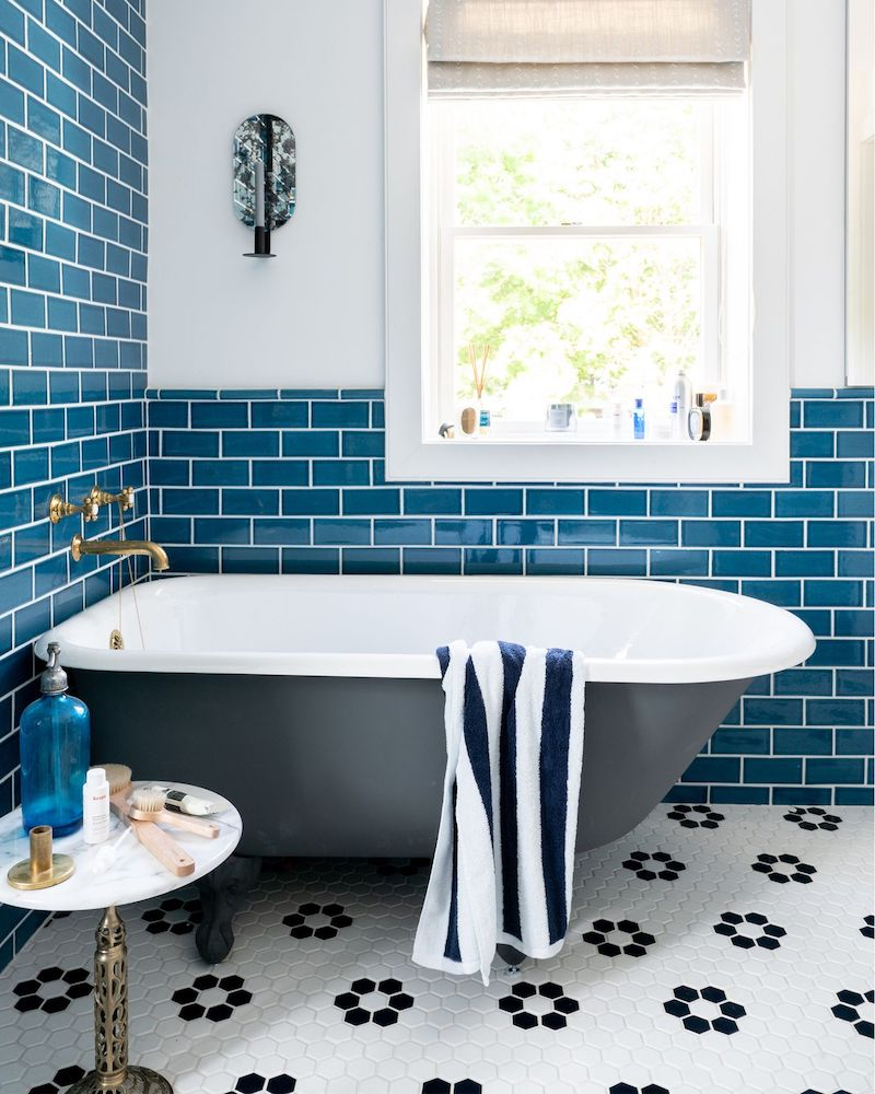 Black bathtub with Blue subway tile in a coastal bathroom
