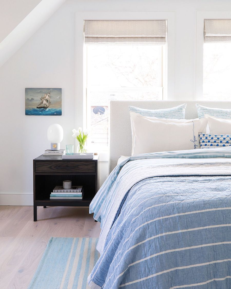 Blue linens in the Beach home bedroom