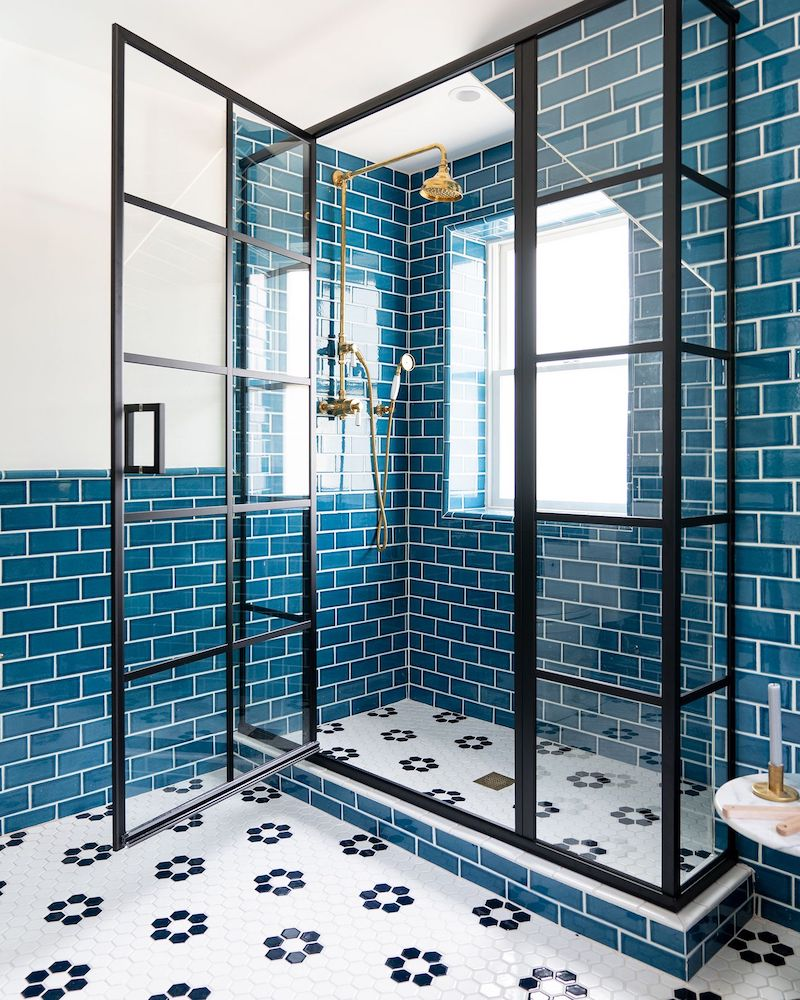 Blue subway tile stand in shower in a beach home bathroom