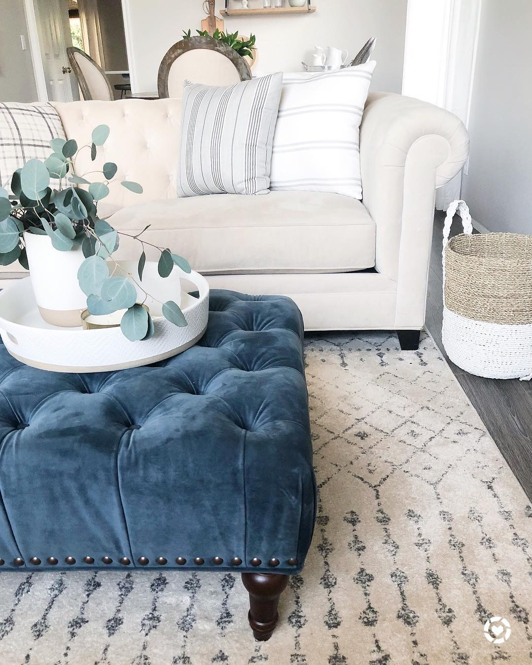 Blue tufted ottoman in Neutral Living room