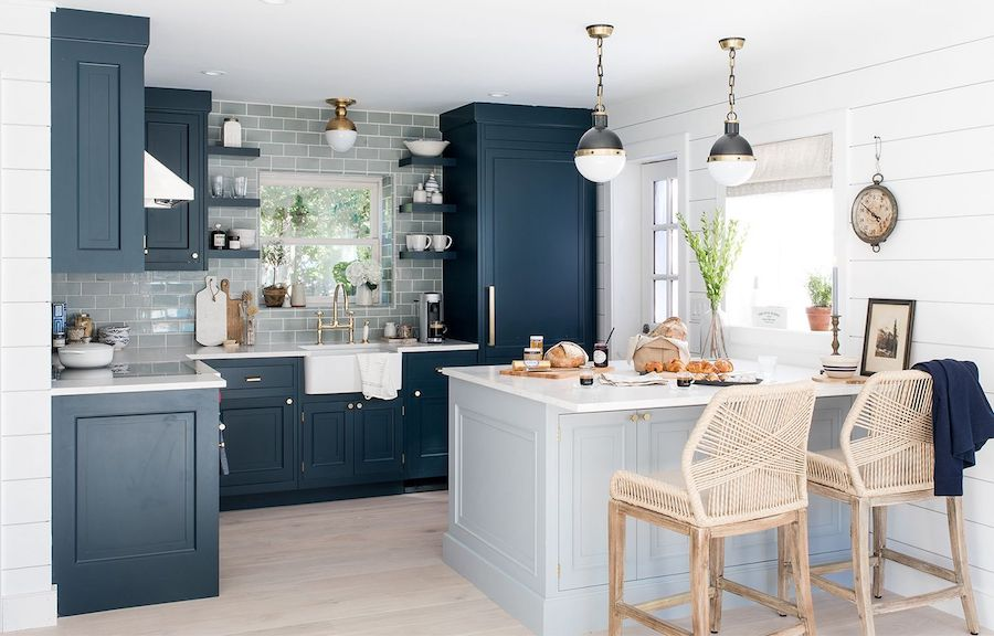 Dark blue kitchen cabinets in a blue beach home