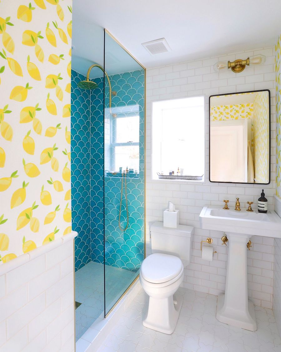 Lemon wallpaper and turquoise mermaid tile in Bathroom