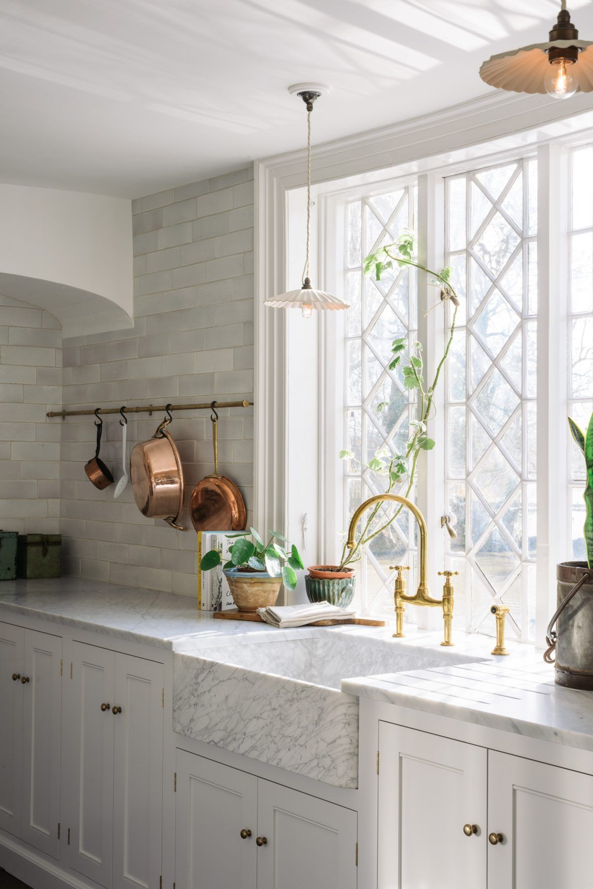 Marble kitchen sink via DeVol Kitchens with Copper Pots and Pans