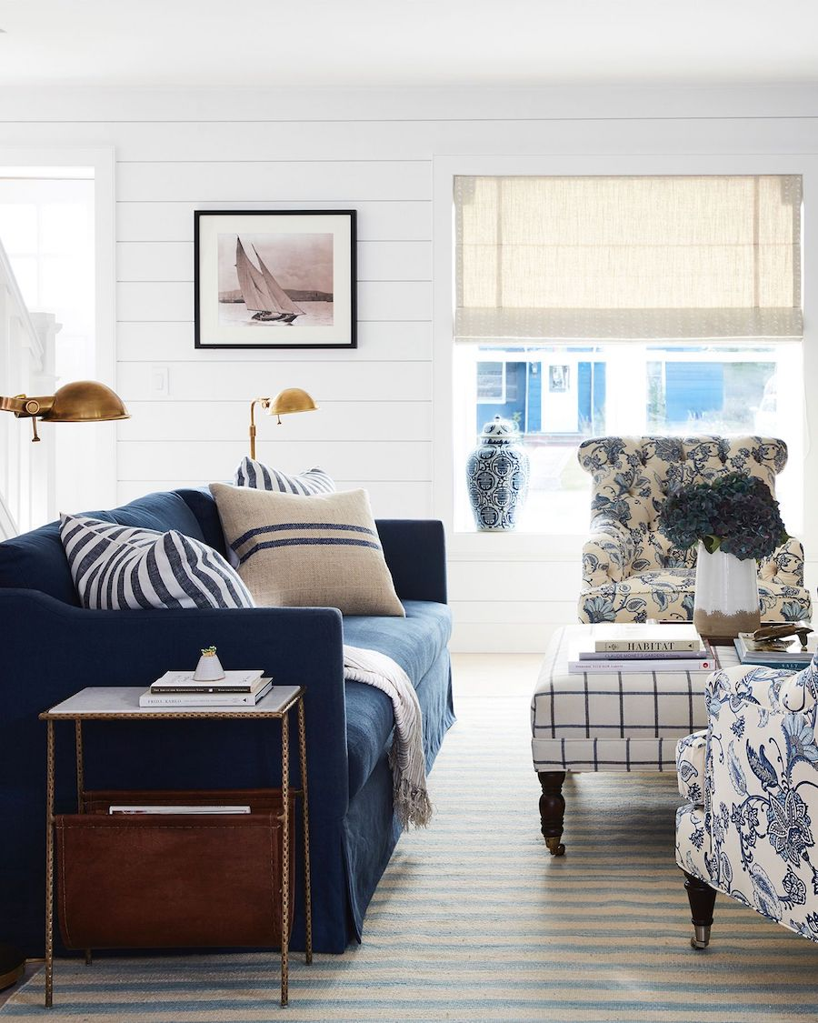 Modern nautical living room with navy sofa
