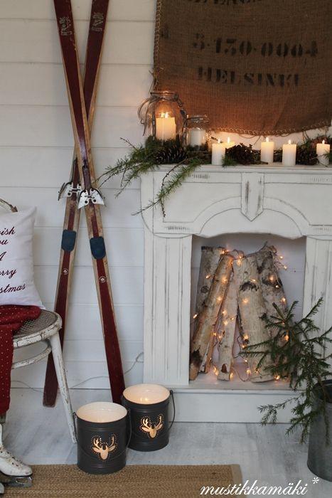Rustic winter fireplace decor with old skiis via mustikkamaki