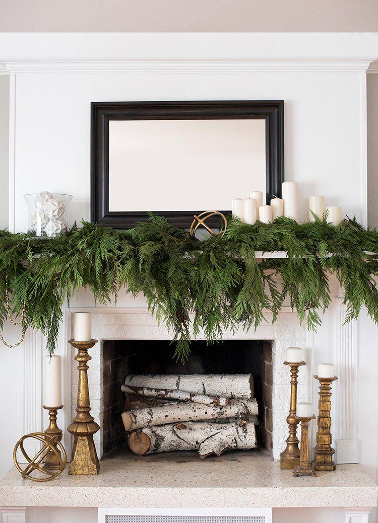 Winter evergreen mantel decor via roomfortuesday