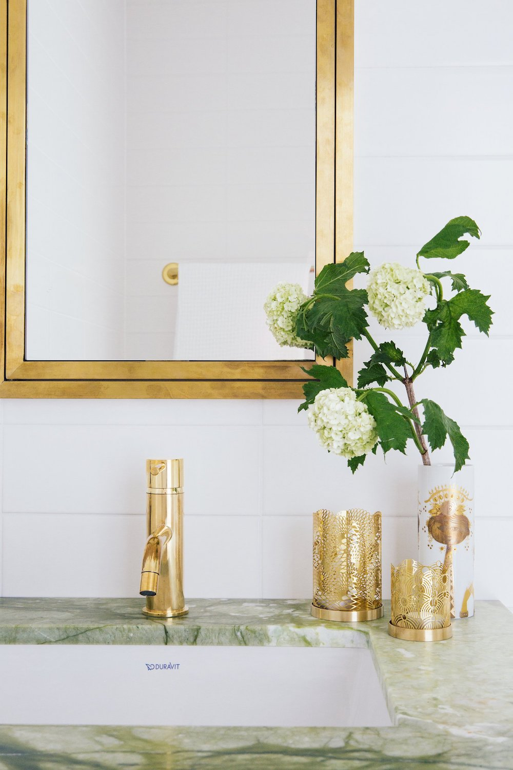 Brass Bathroom Accessories and Fixtures with Duravit Sink and Brass Faucet via Paris Forino