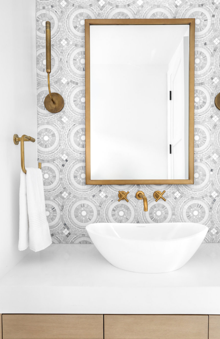 Brass Towel Ring with vessel sink and brass bathroom mirror via Lynde Galloway