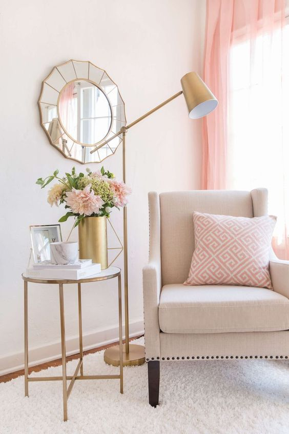 Beige accent chair with pink curtains and pink pillow