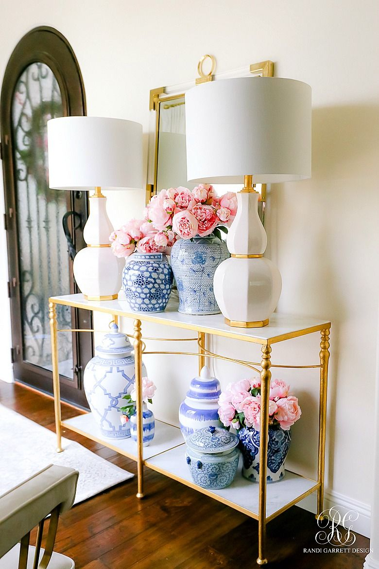 Feminine entryway with lots of flowers via randi garrett design