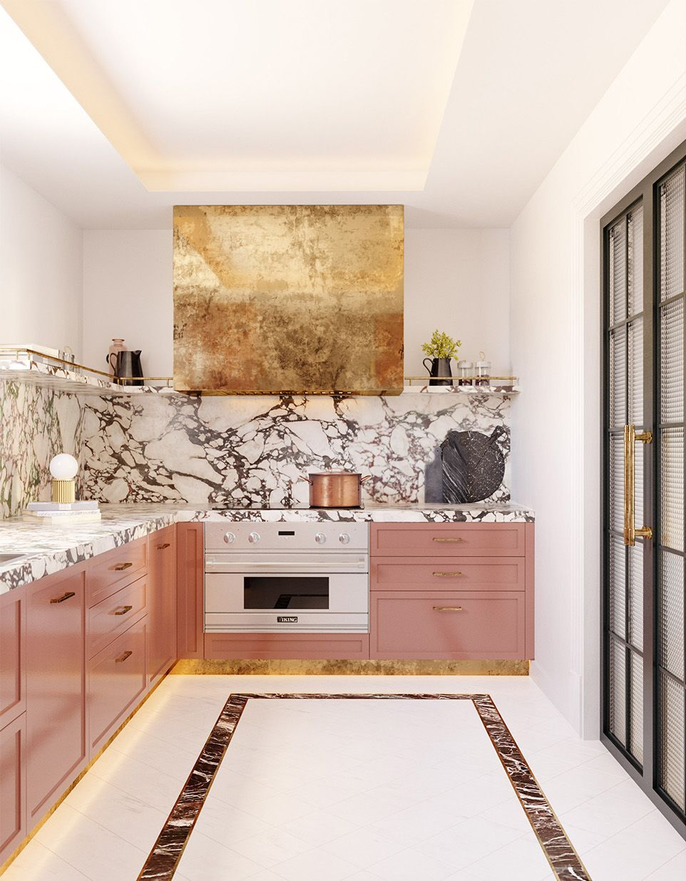 Feminine kitchen with coral brass cabinets and marble backsplash via Jaime Beriestain