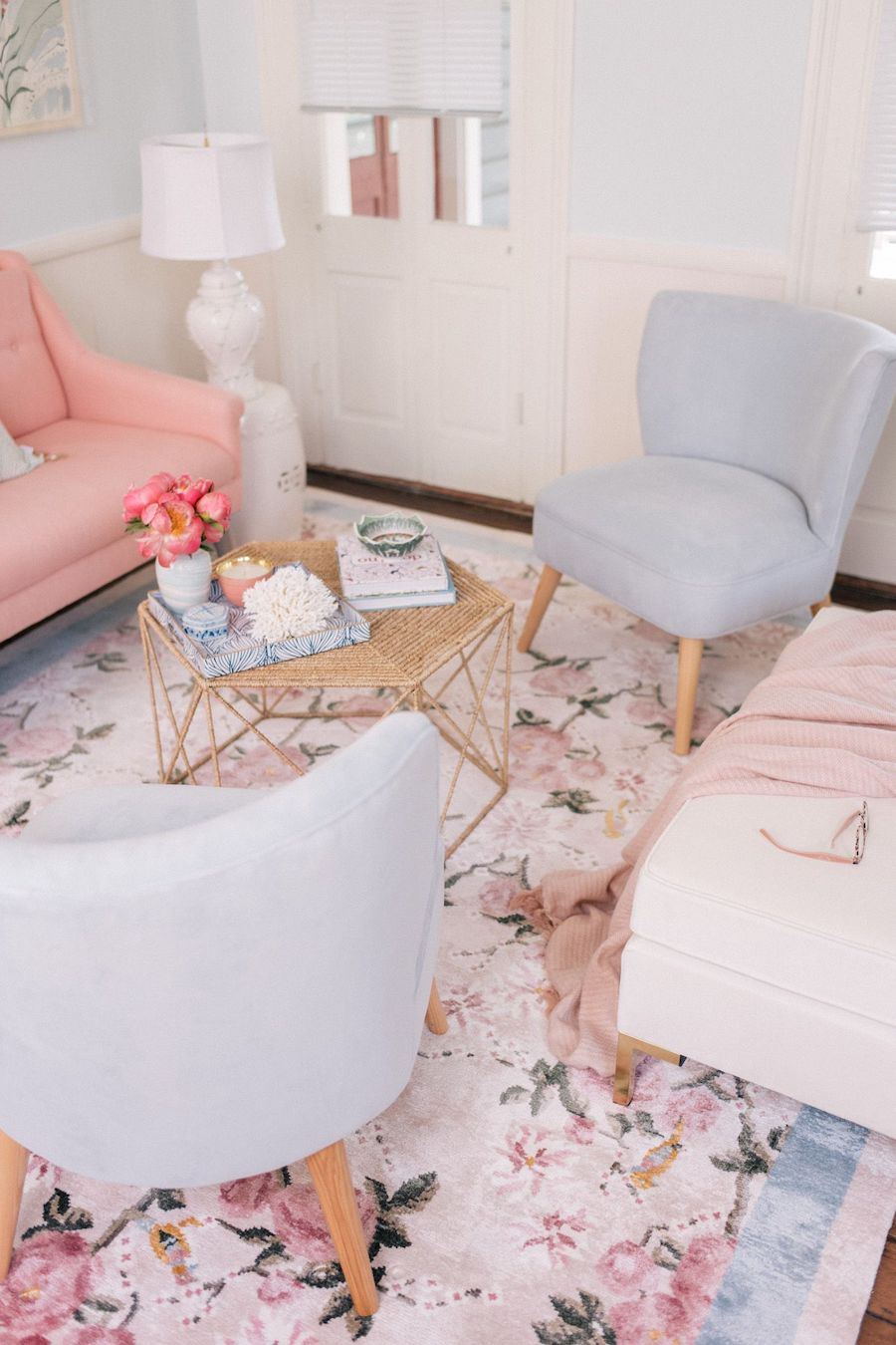 Floral living room rug via Gal Meets Glam