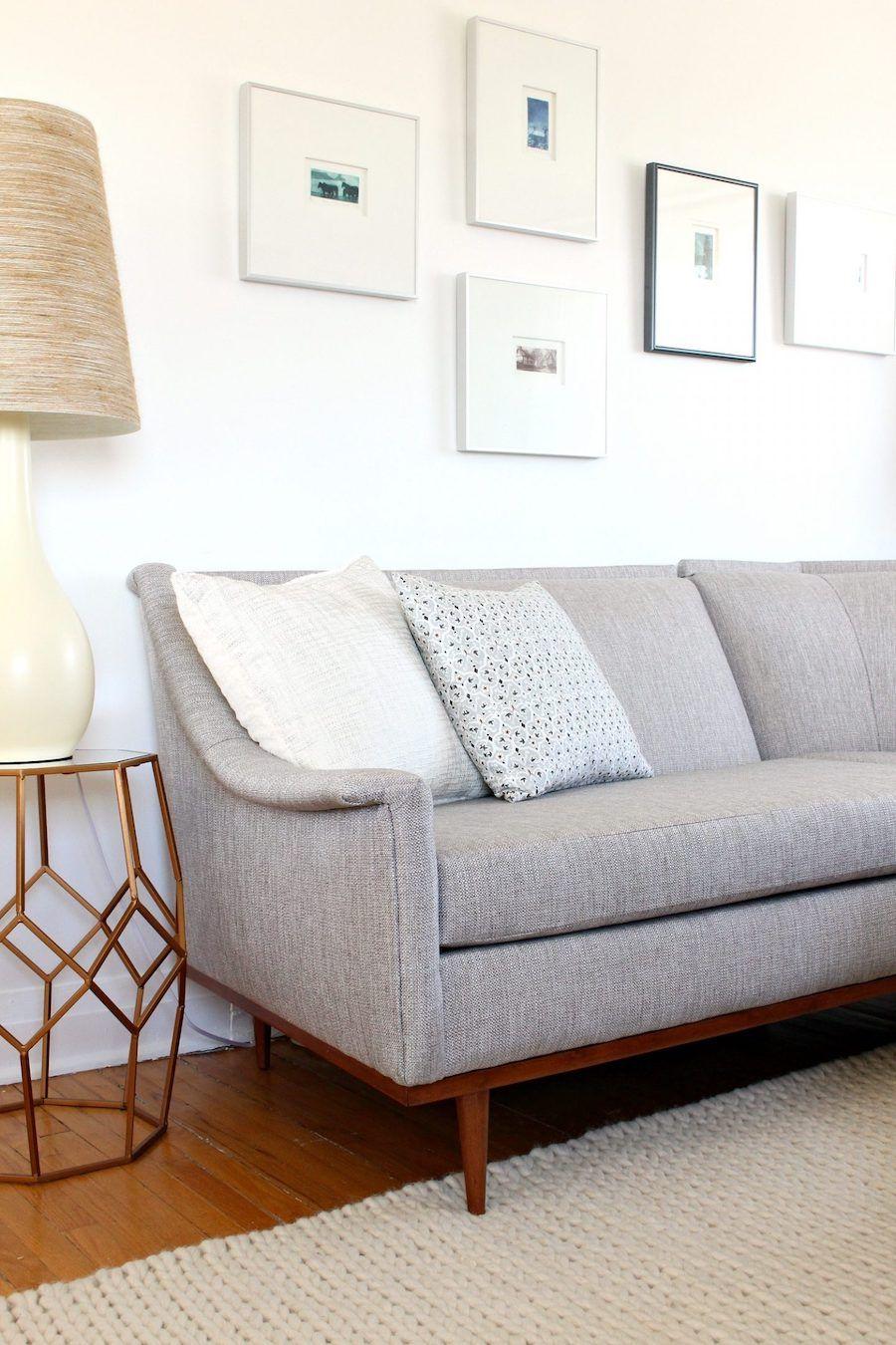 Gray mid-century modern sofa in living room
