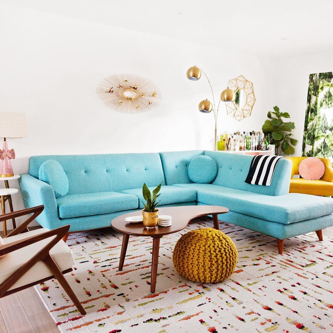 Mid-century modern teal sofa via @melodrama