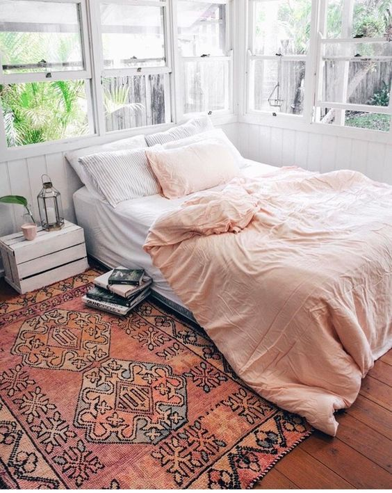Pink comforter and pink bedroom rug