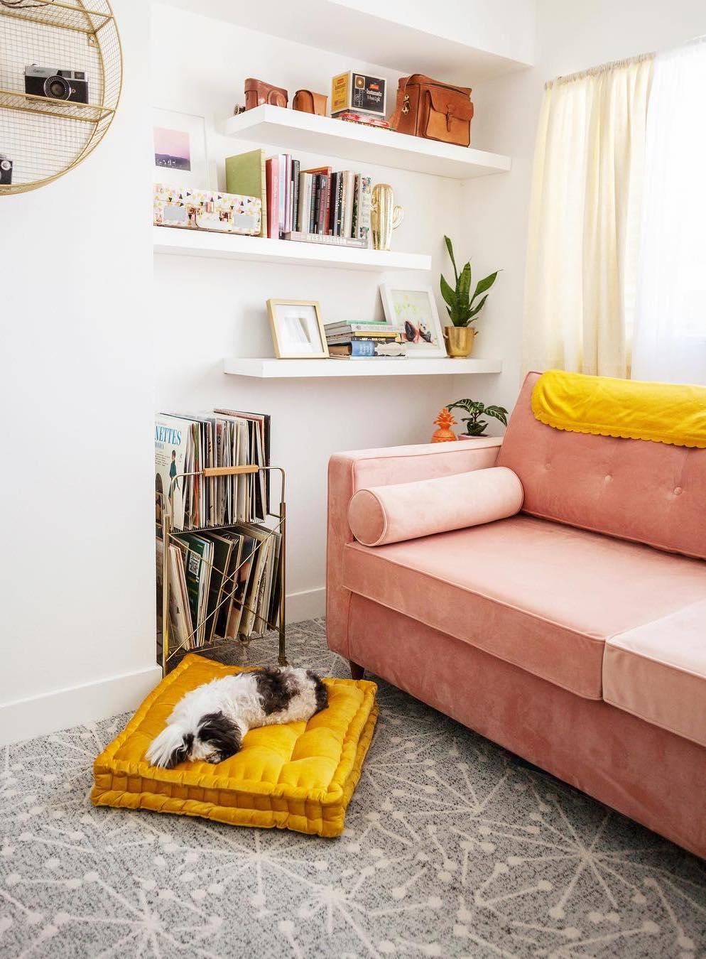 Pink mid-century modern sofa via @melodrama