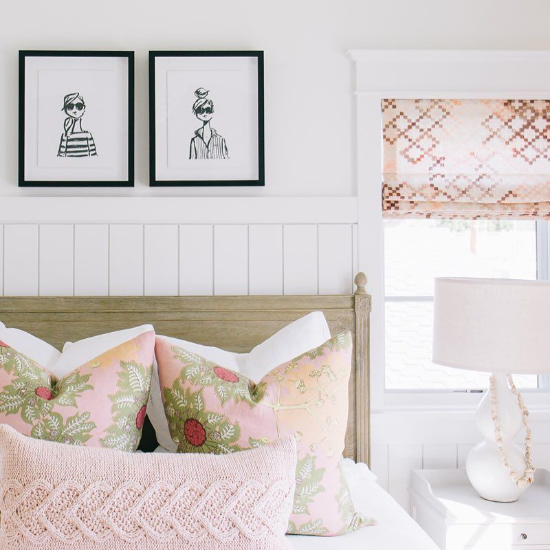 Pink throw pillows on the bed via @kellynuttdesign