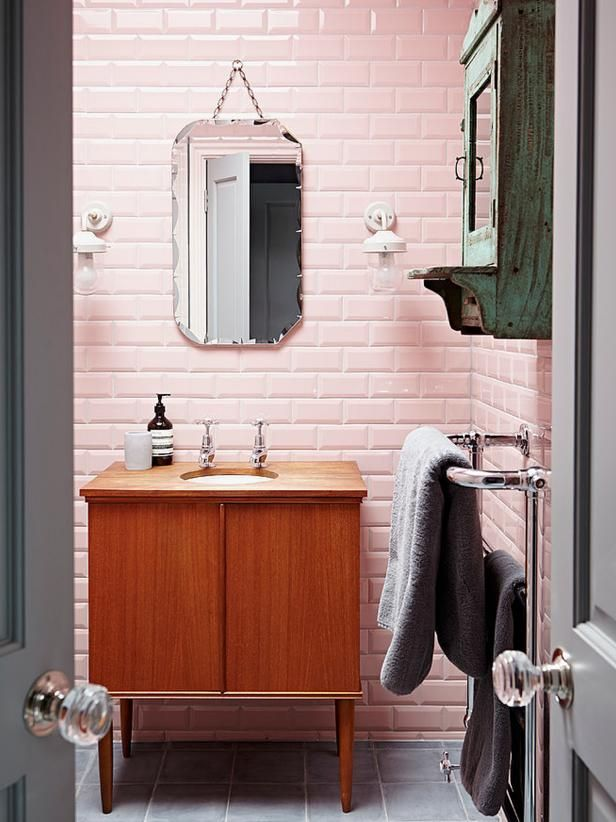 Pink tile mid-century modern bathroom via Home Adore, design by Godrich Interiors