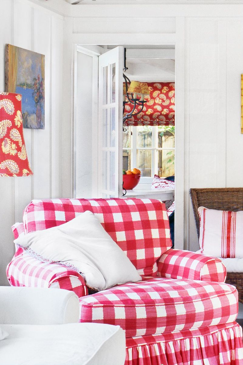 Red plaid accent chair in country living room via @countryliving