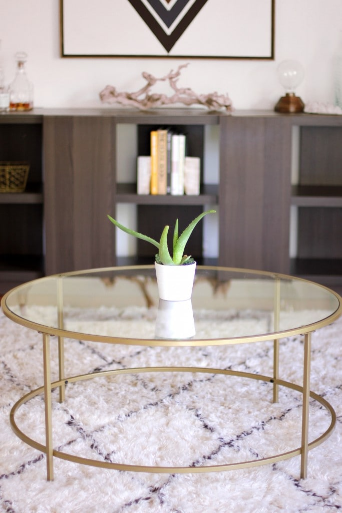 Gold and glass round coffee table via Best Friends