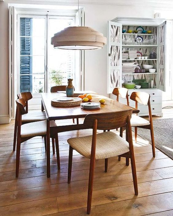 Rounded back mid-century modern brown dining chairs