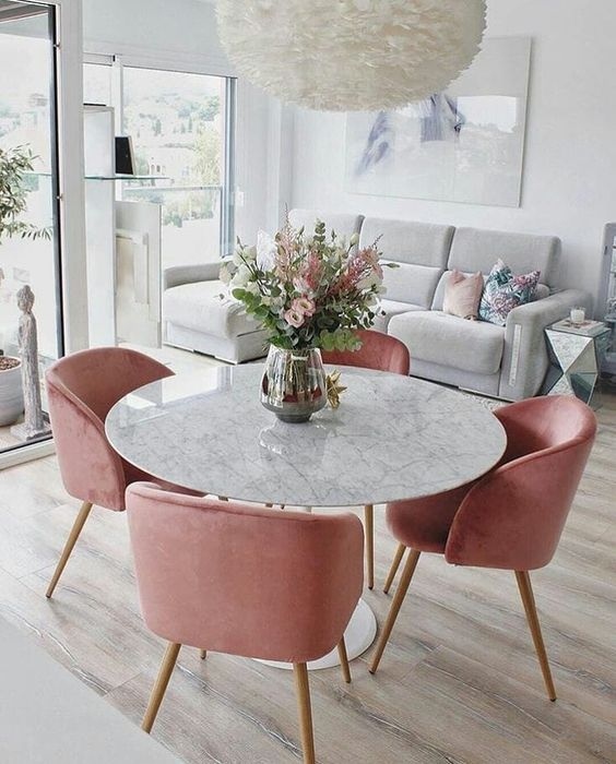 Velvet dining chairs with marble dining table