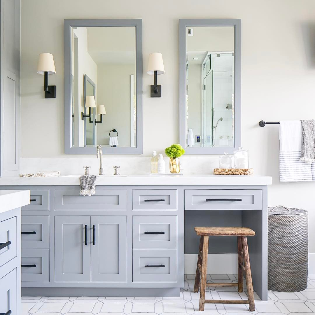 Bathroom with gray blue cabinets via @brookewagnerdesign