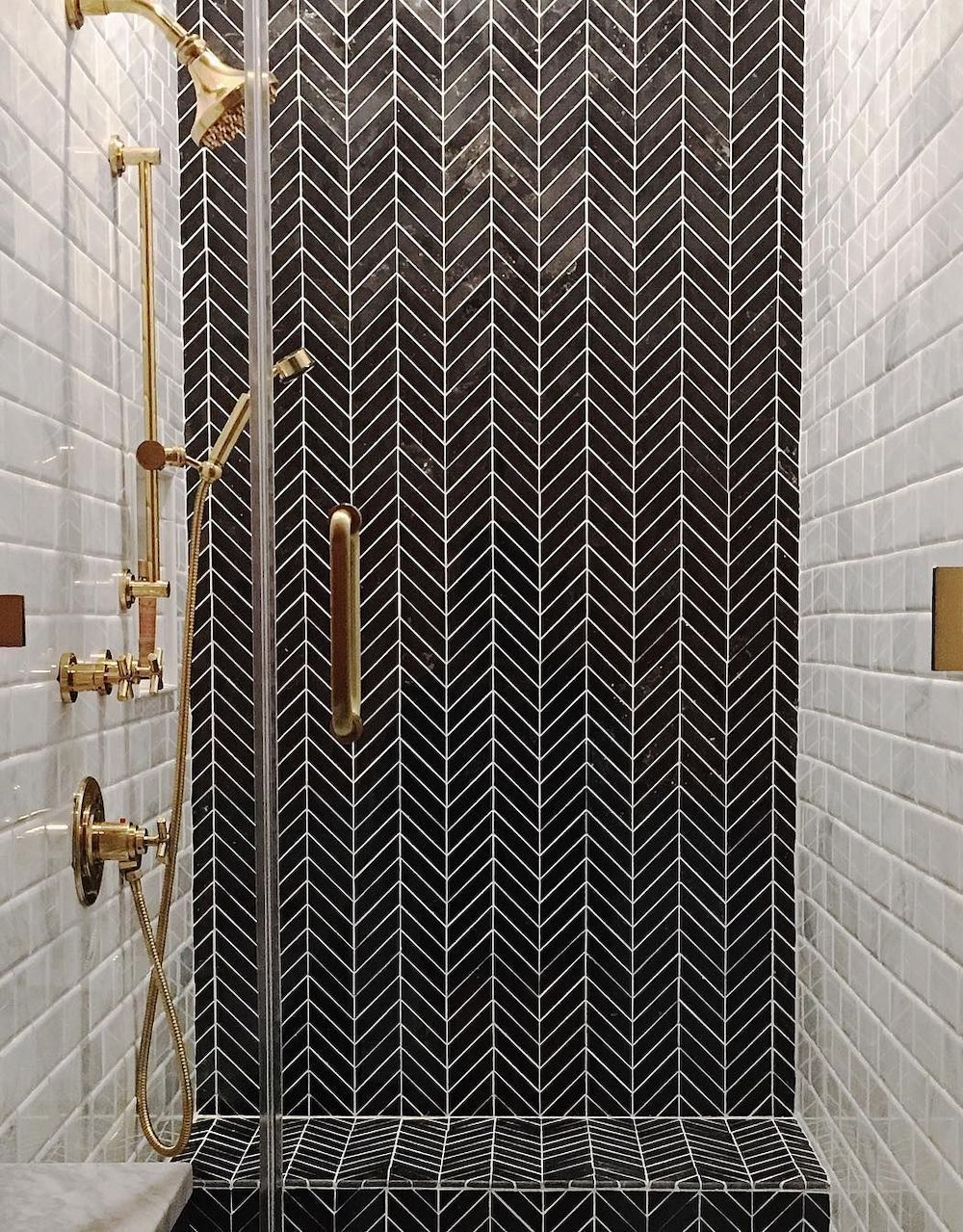 Bathrooms with Black Herringbone wall Tiles @jordansvaughn
