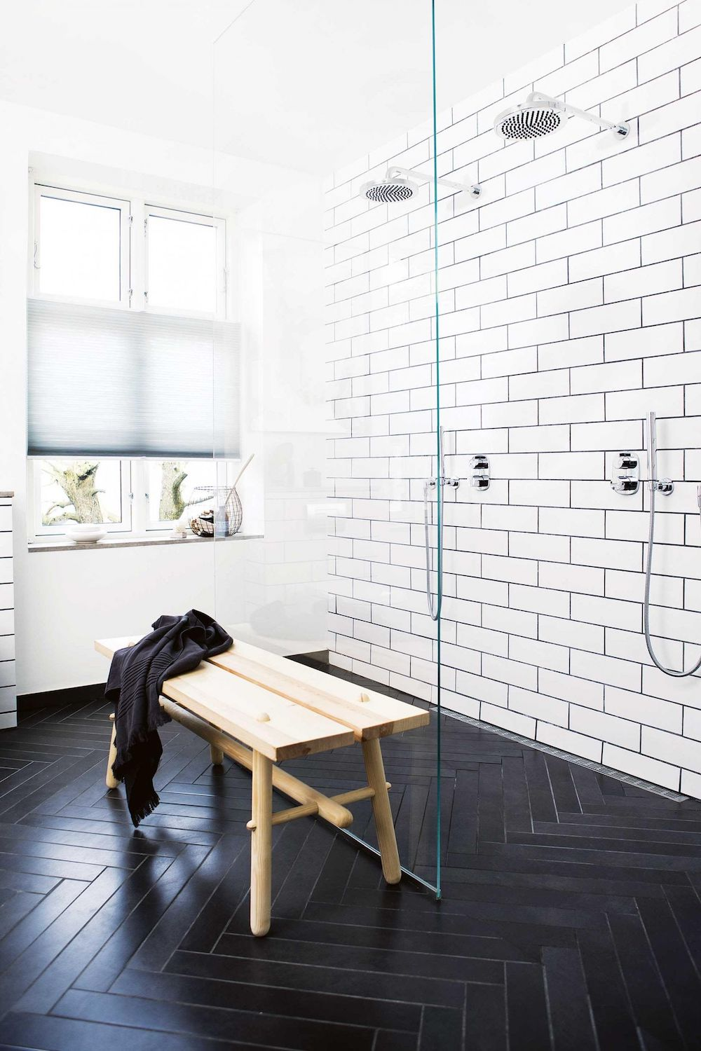 Bathrooms with Black Herringbone Floor tiles via Inside Out
