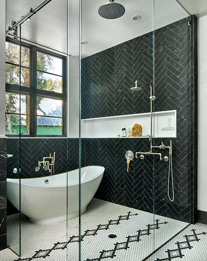 Bathrooms with Black Herringbone wall tiles via mountainliving
