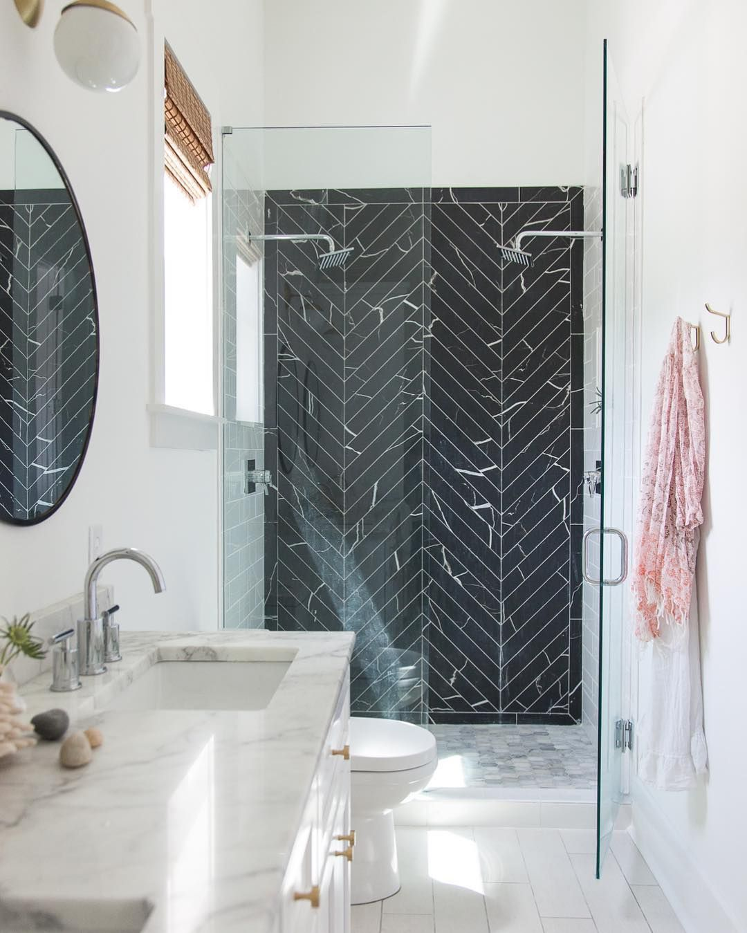 Bathroom shower with black marble herringbone tiles via @hannahcrowell