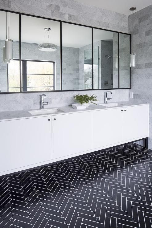 Bathrooms with black herringbone tiles on floor via Martha O'hara interiors