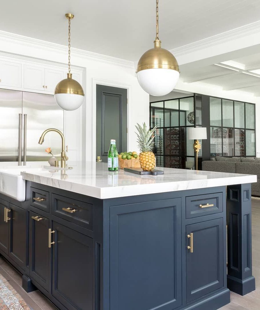 Brass Pendant Lights in Kitchen with blue cabinets via @laurauinteriordesign