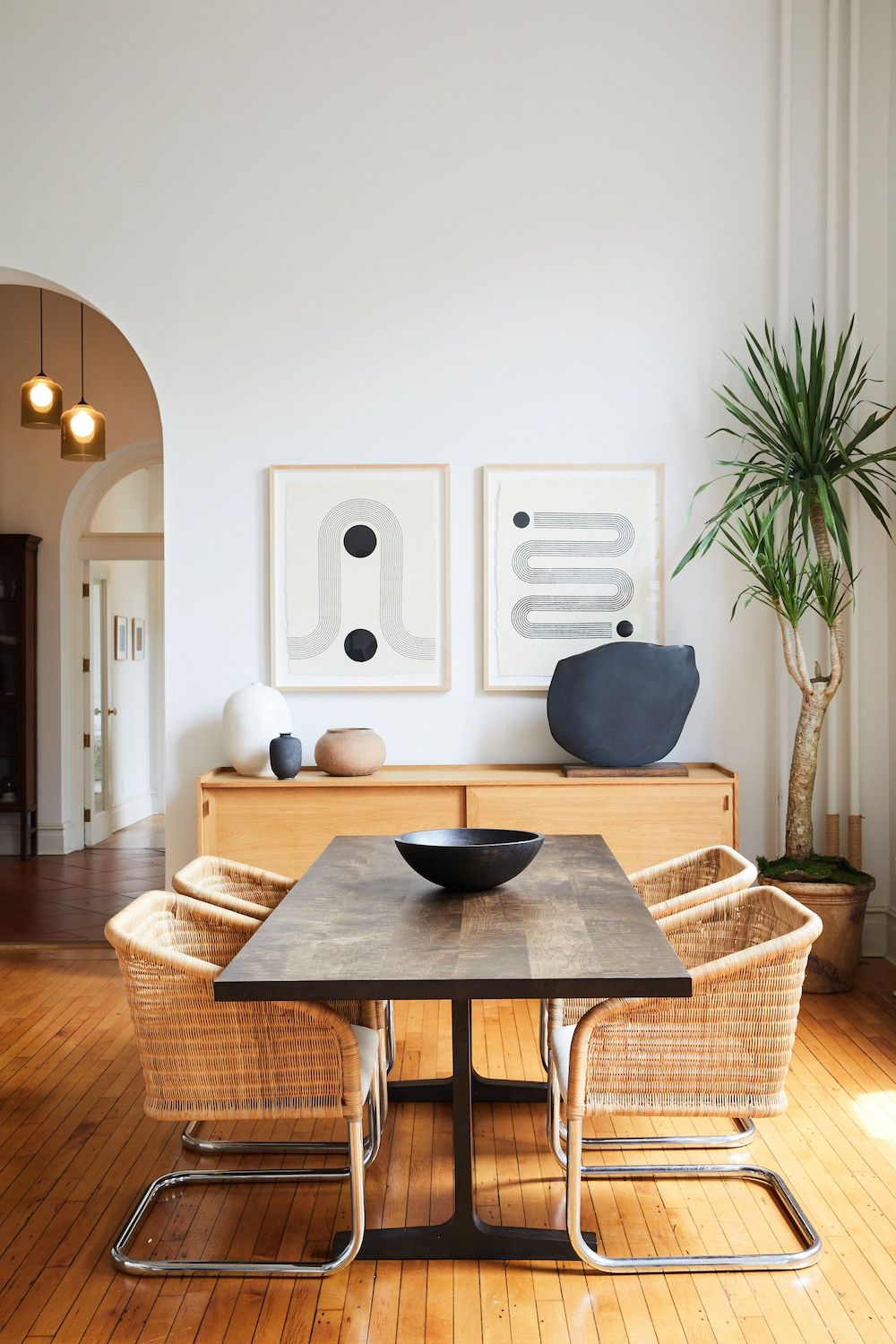 Dining Room with Dark wood table and wicker chairs via spaceexplorationdesign