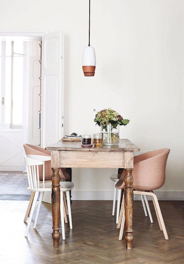 Eclectic dining room with wood dining table