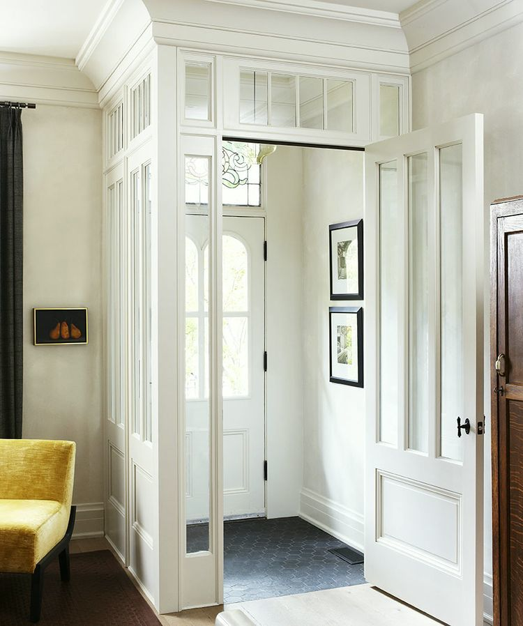 Enclosed entryway with glass windows via Douglas Design Studio