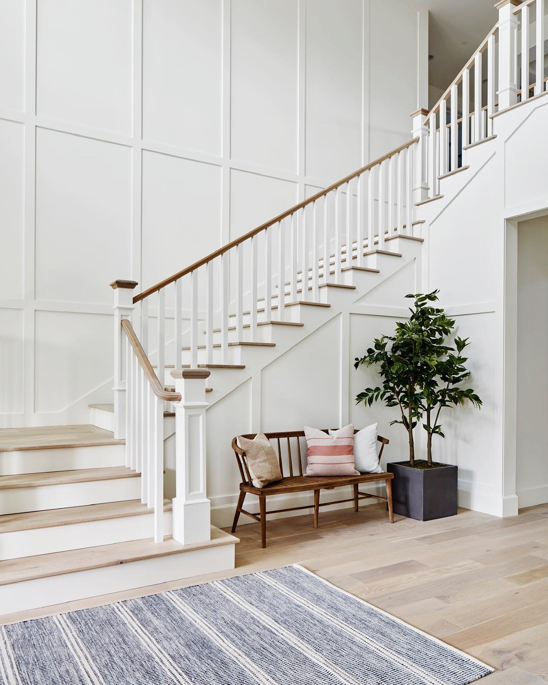 Entryway with Staircase via @aft_construction