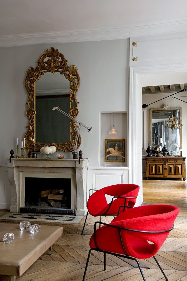 Minimal red accent chairs in Parisian apartment via cotemaison