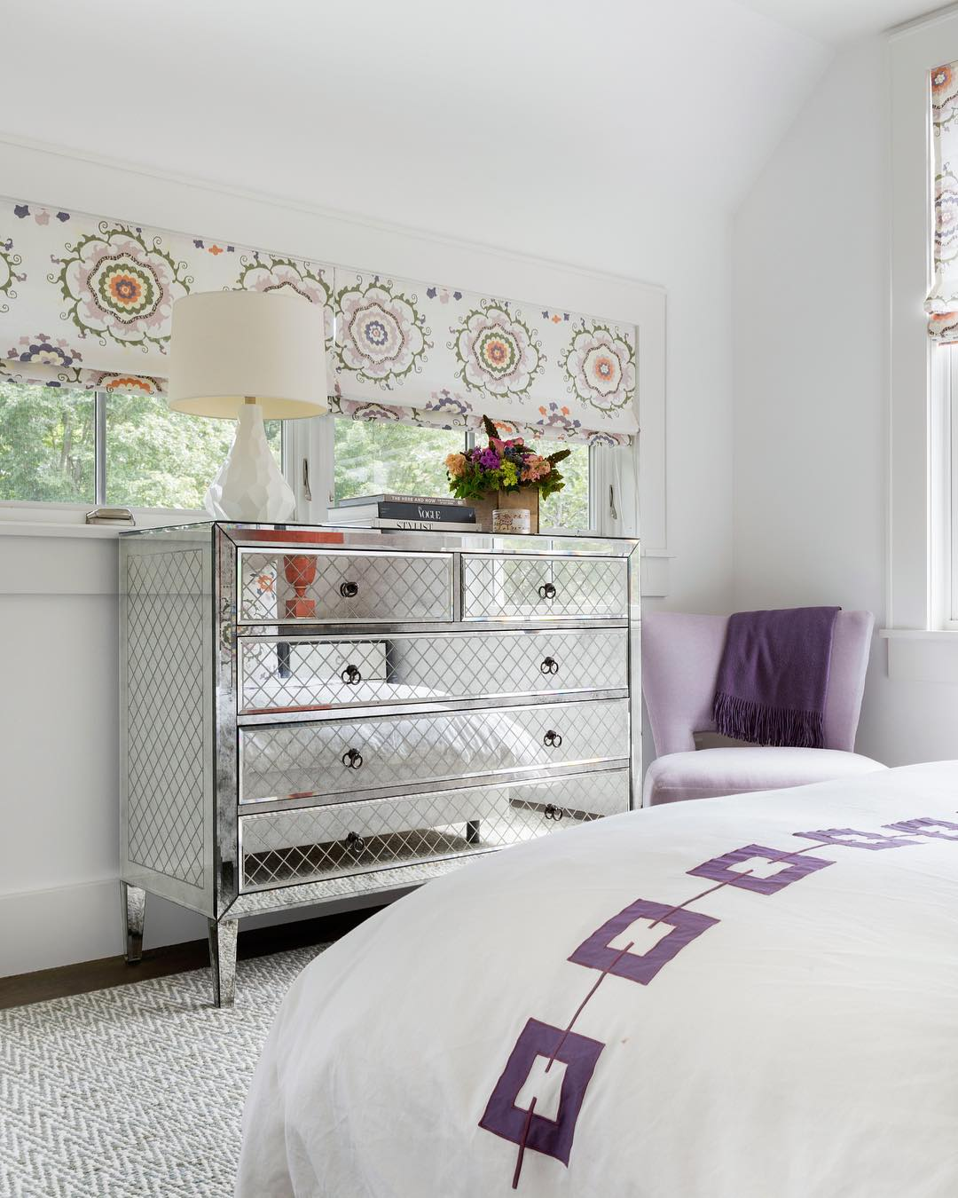Mirrored Dresser in Bedroom with Purple side chair via @andrewflesherinteriors