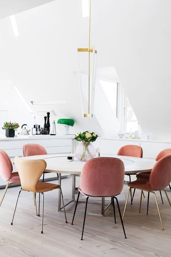 Pink velvet dining chairs in modern dining room