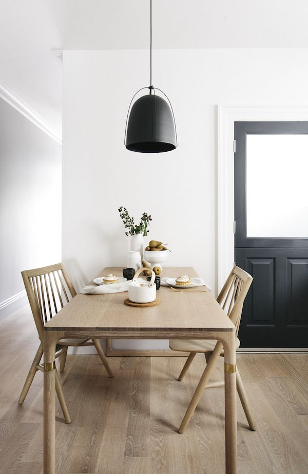 Scandinavian Dining Room with warm natural wood dining table and black pendant light via Luft