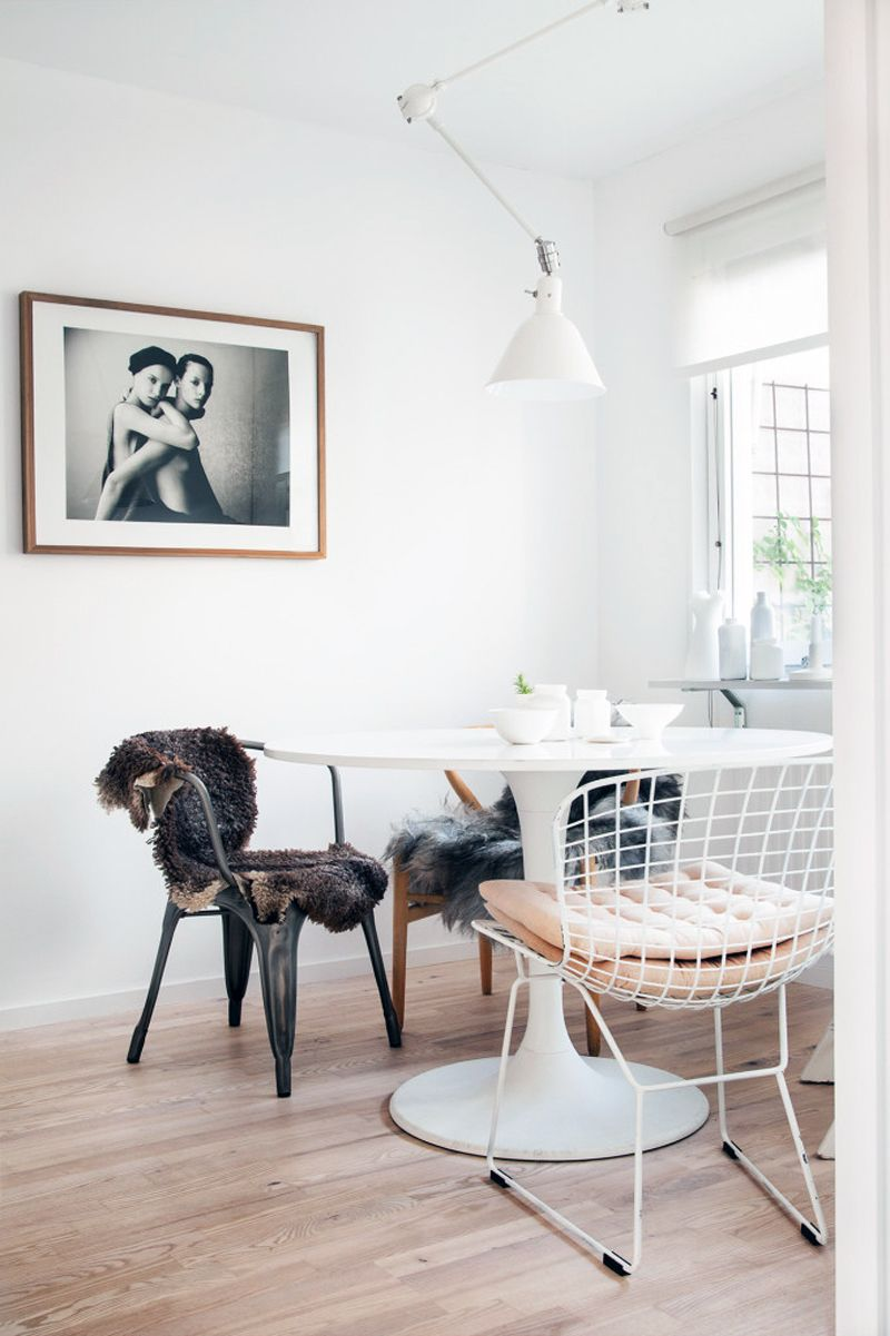 Scandinavian Dining Room with sheepskin throws on metal dining chairs, Sofie Sykfont