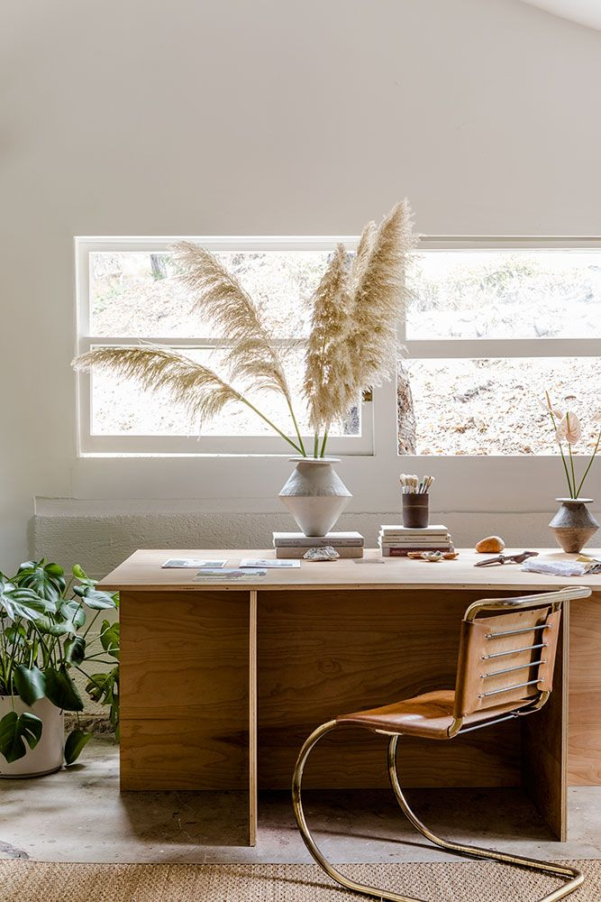 Scandinavian Home Office with Pampas Grass and wood desk via thisrepresents