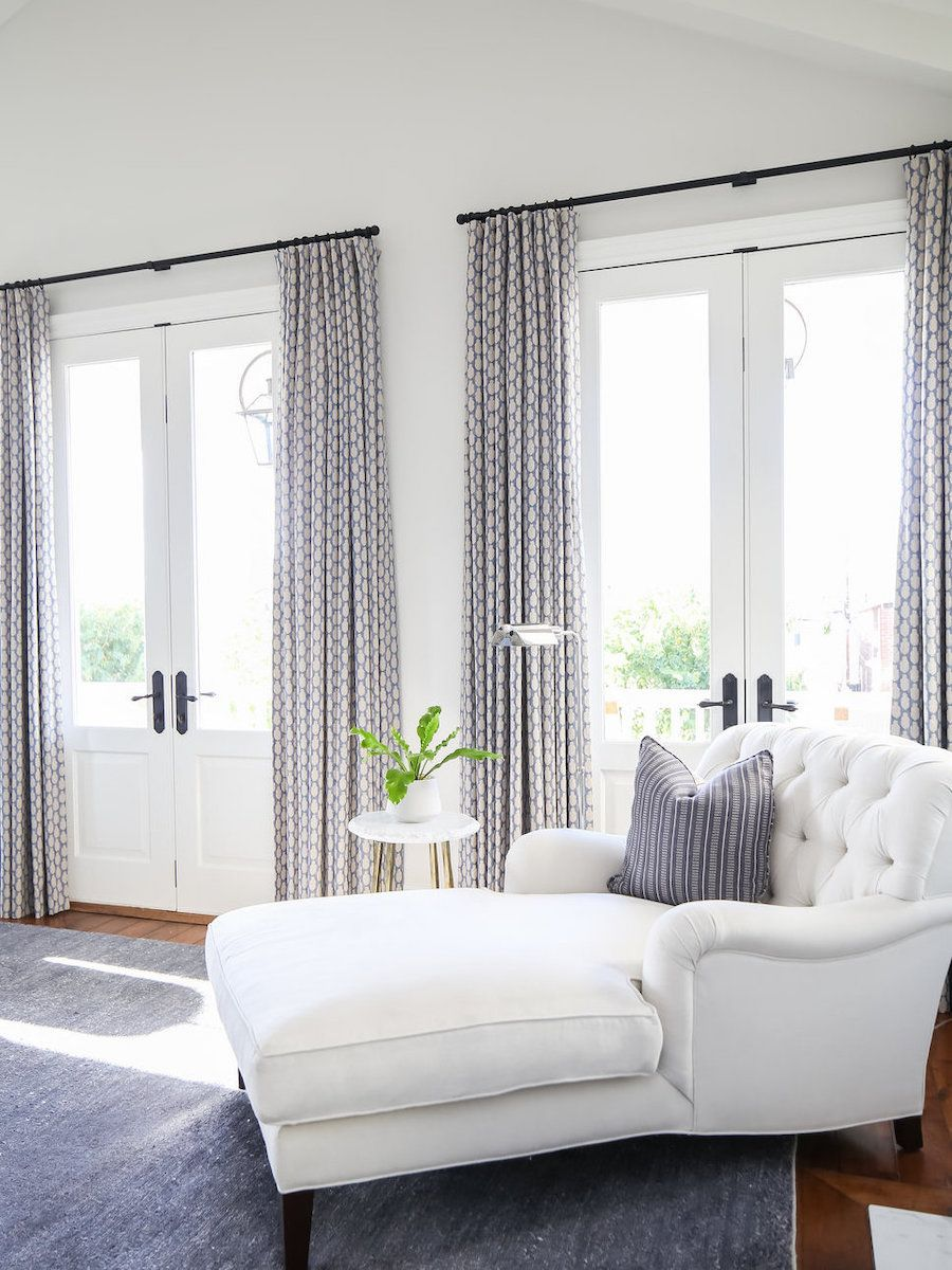White tufted chaise lounge via Brooke Wagner Design