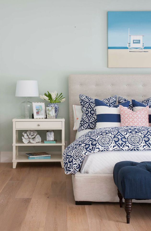 Coastal Bedroom with beige linen tufted headboard via AGK Design Studio