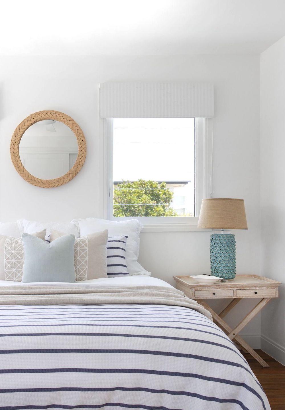 Coastal bedroom with nautical blue striped bedspread @donna_guyler_design
