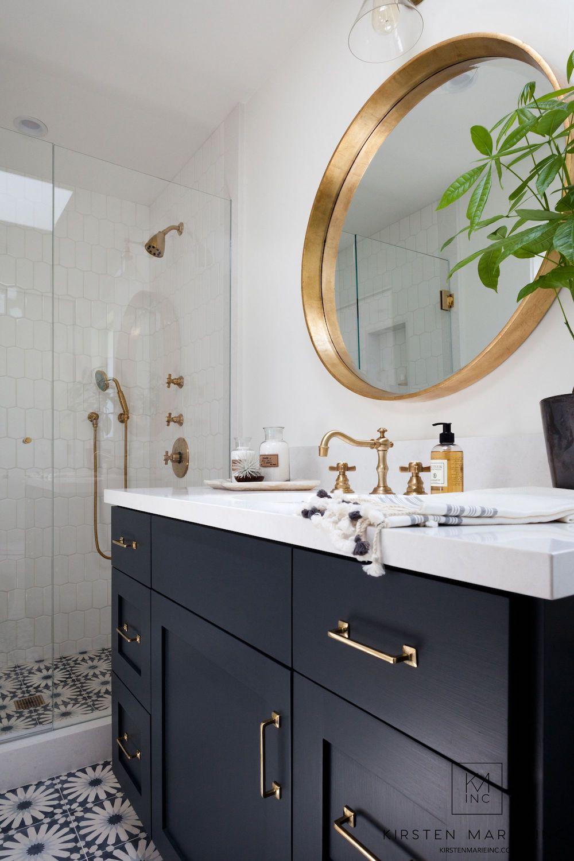Round gold mid-century modern mirror via Kirsten Marie